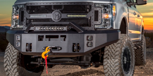 Magnum Front Bumpers feature recessed light hole pockets and certain applications are available with a winch shelf.